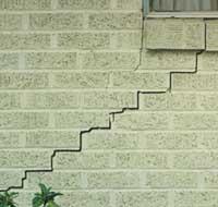 Diagonal crack in exterior brick wall