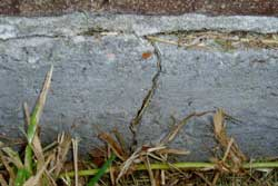 Warning Sign Exterior: crack in slab wall